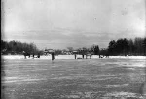 Cutting ice at Cushing Pond