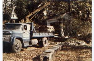 Installing the portico in the Old Ordinary's garden (1979)