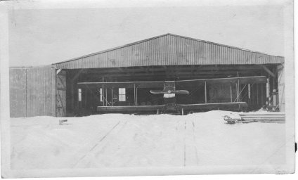 Biplane in a hangar at Bayside Airport, Huit's Cove, Hingham.  (John Richardson Collection, Hingham Historical Society)